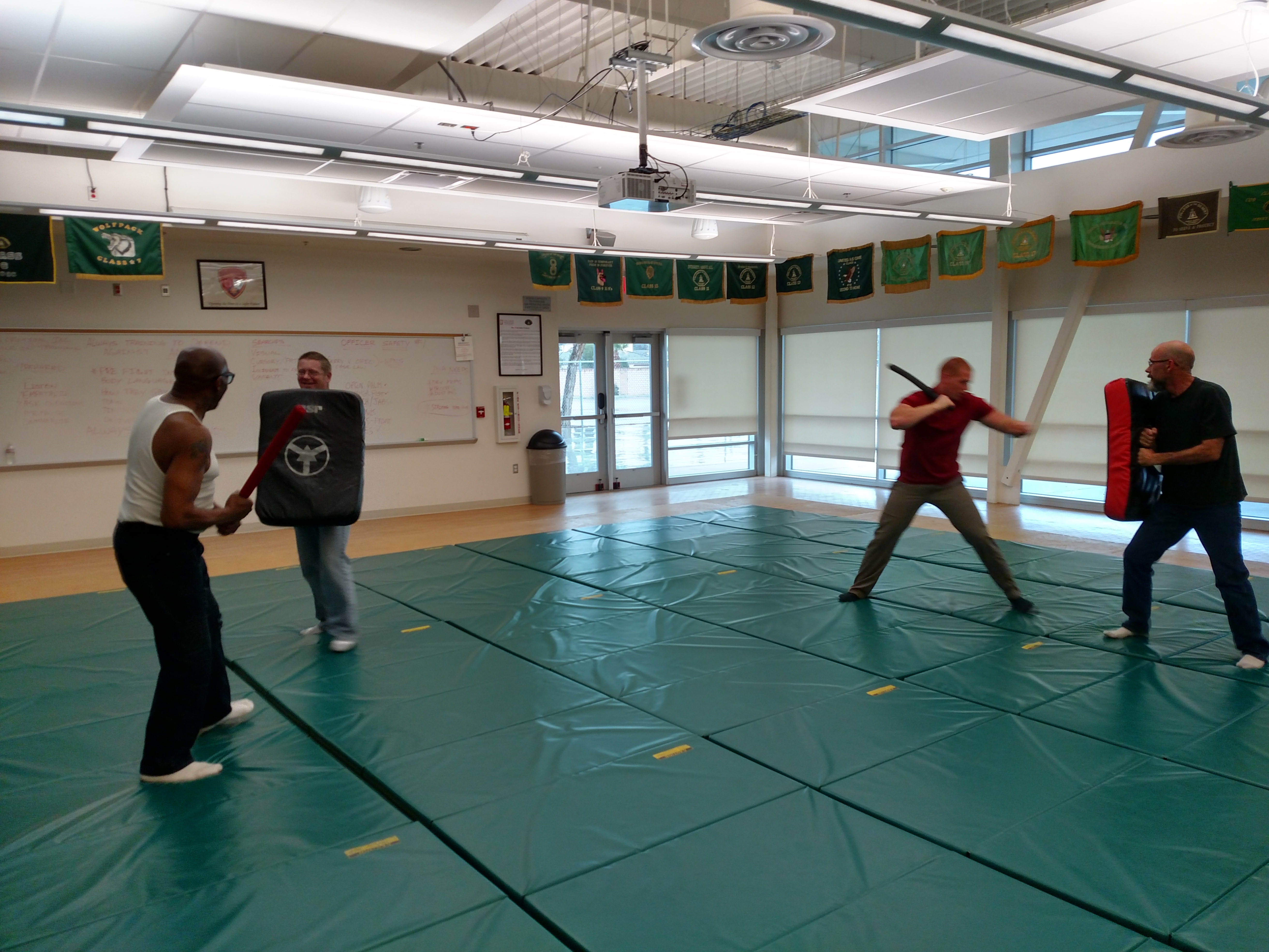 Students practicing with billy club
