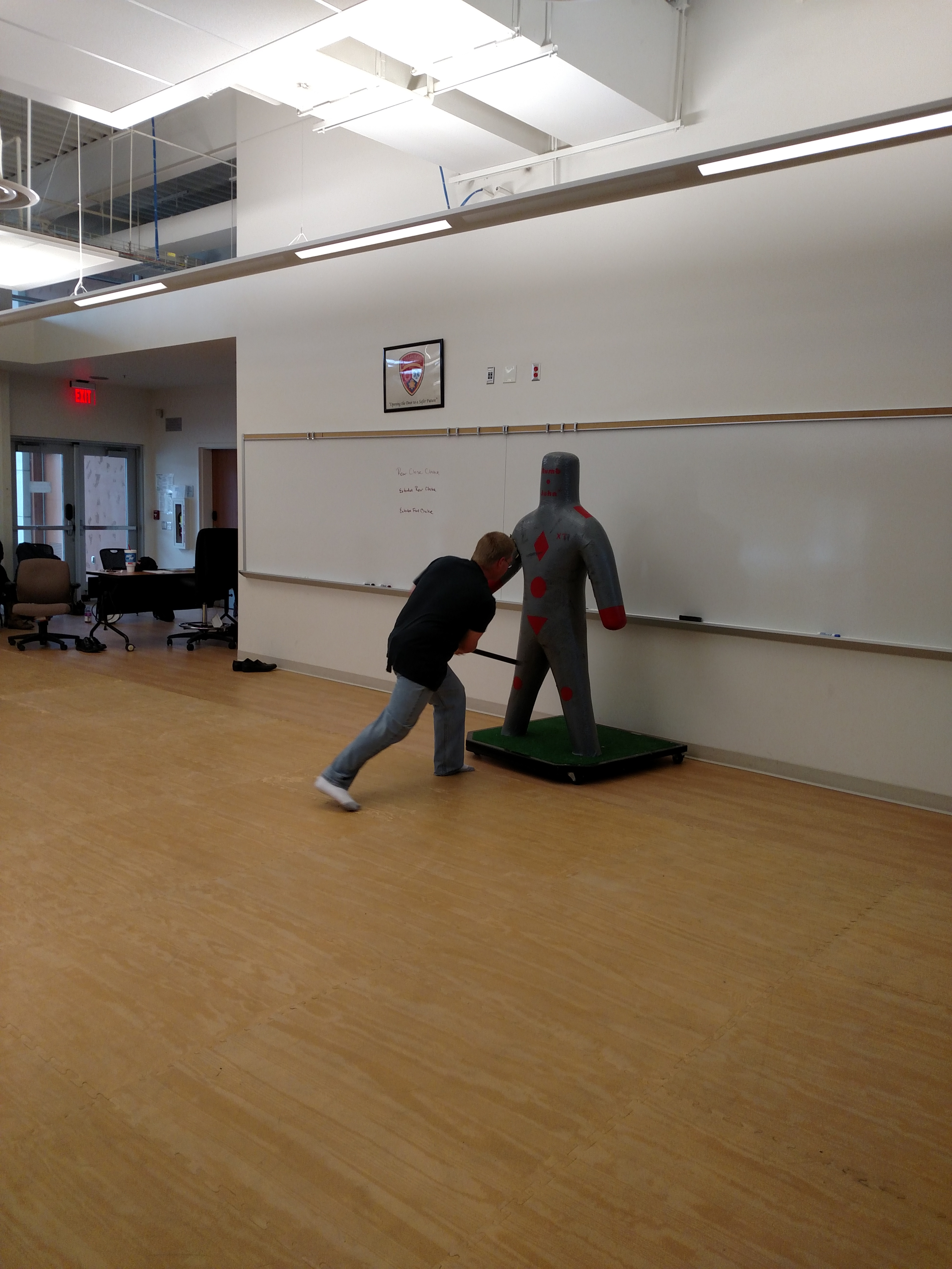 Student practicing take down methods with club