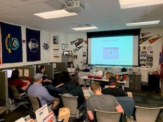Student veterans watching presentation on financial literacy